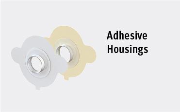 Adhesive Housings
